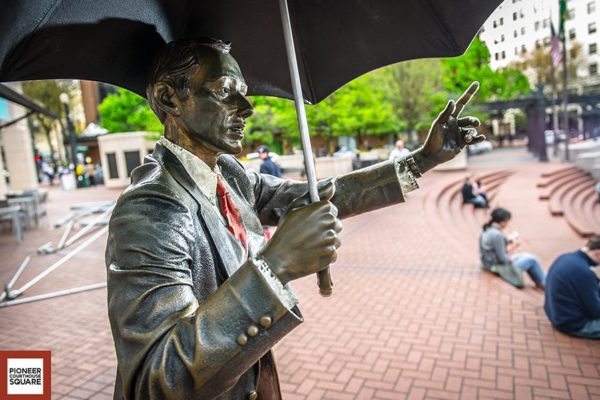 Allow Me - Serving as a signature Portland icon, this bronze life-sized sculpture of a man offering his umbrella, was created by nationally known artist J. Seward Johnson of Princeton, New Jersey. The sculpture joins a number of Johnson's works in public spaces in cities such as New York, Kansas City, Los Angeles and Oakland, California.
