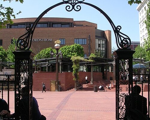 Portland Hotel Gate - Located where it once stood at the original Portland Hotel entry, the exquisite gate is directly across from Pioneer Courthouse. The wrought iron gate and fence are believed to have been designed by McKim, Mead and White, architects of the Portland Hotel. During the hotel's history only one president, Warren Harding, did not pass beneath this lovely feature.
