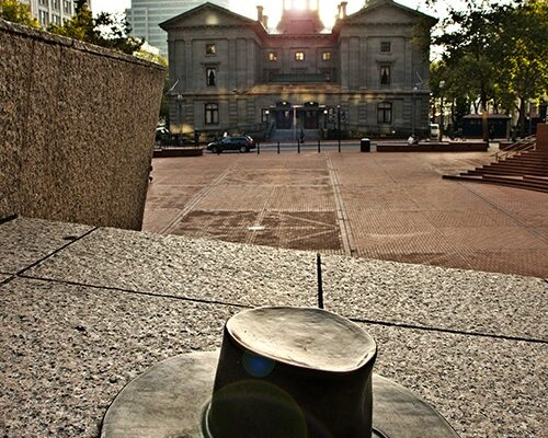 Will Martin's Hat - In 1980, Willard Martin's team submitted the winning design of Pioneer Courthouse Square to the Portland Development Commission, prevailing over 160 submissions. As a tribute to his great design, a bronze replica of Will's signature wide-rim river hat is located next to the keystone lectern, above the Visitor Information Center—as if he had tossed it there while walking by today.